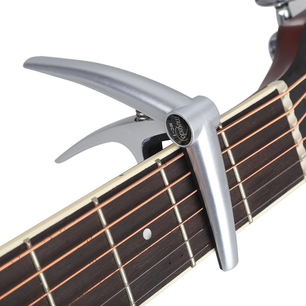 Аксессуары для гитары. Каподастр.